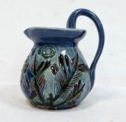 Brannam Barum pottery jug, possibly by Liverton, flared and having sgraffito decoration of a fish on