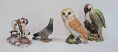 Three various Beswick ceramic model birdsto include a woodpecker, an owl and a wood pigeon anda