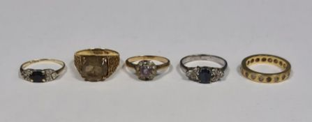 9ct gold ringwith yellow-coloured stone, 2g total, a gold(?) full eternity ringwith white