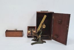 Metal and brass microscopein wooden box anda bone and ivory nine-spot domino setin 19th century