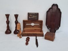 Pair of turned wooden candlesticks, a carved wooden box, another, a wallet depicting pyramids to
