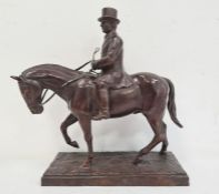 Bronze sculpture of huntsmanwearing top hat, on horse, on rectangular stepped base, unattributed,