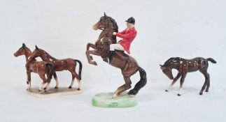 Beswick pottery glazed huntsman on horseback and two pottery model horseswith brown glaze (3)