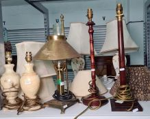 Various table lamps to include two wooden table lamps, brass paraffin lamp converted to