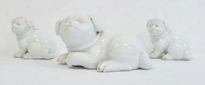 Three various Japanese Meiji period Hirado white glazed porcelain models of Akita puppies, each