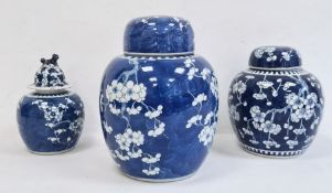 Large Chinese porcelain ginger jarwith prunus blossom on a blue wash ground, lidded, ovoid, 26cm