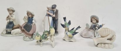 Two various Lladro figures, one with a girl carrying a basket the other seated with a dog,a Nao