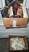 Box of assorted handbags and a box of table linen, tea cosys, etc