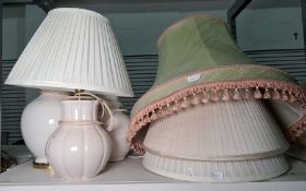 Three cream ceramic table lamps, not matching and four pleated shades of various sizes (7)