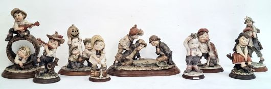 Collection of nine various Capodimonte figuresby G Armani to include 'Gulliver's World' and other