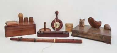 Carved wooden inkwellin the form of a cat with glass eyes,various wooden eggcups, a desk tidywith