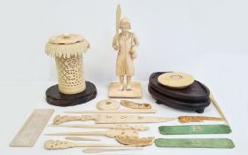 Small collection of antique carved ivoryto include standing male figure with broad bladed knife,