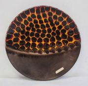 Harris studio hand-painted Staffordshire pottery chargerdecorated in brown, flaming yellow and