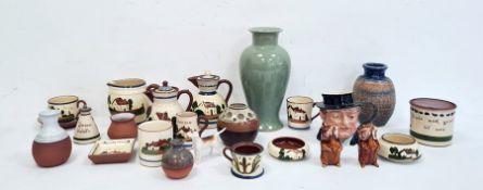 St Agnes part glazed blue and brown pottery ovoid vase, a green celadon-style crackle glazed vase, a