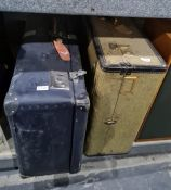 Large vintage travelling suitcase and another containing assorted table and other linen (2)