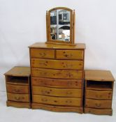 20th century serpentine fronted chest of six drawers, two pine bedside chests and a table-top mirror