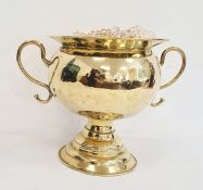 19th century high polished brass two-handled bowl on stepped pedestal base, 28cm high and a