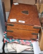 Brass cornered sewing box and contents, a quantity of materials, offcuts and two suitcases