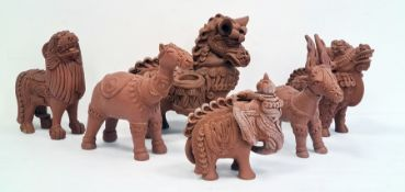 Collection of six various terracotta and glazed pottery model animalsto include stylised