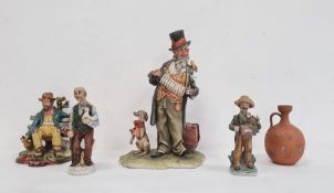Collection of four various Capodimonte-style unglazed pottery figuresto include a Portuguese