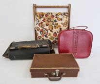 Gladstone bag (some damage), a small brown fibre suitcase, a red plastic vanity case and a stained