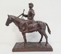 Bronze sculpture of jockey on horse, on stepped rectangular base, unattributed, stamped 'Green and