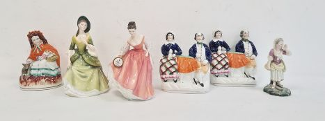 Pair of 19th century Staffordshire pottery flatback figuresof lady and gentleman seated,another