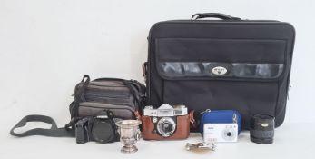 Paxette Reflex camera, a Minolta camera and lensin carry case, a Vivitar digital camerain blue