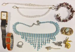 Quantity of costume jewelleryto include brooches, bangles, beaded necklaces, etc (1 box)