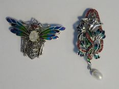 Silver, marcasite and plique a jour enamel dragonfly brooch, having facet cut white stone body and