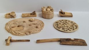 Small collection of antique Japanese carved ivory to include basket of fruit and other pieces on