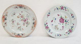 Two 18th century Chinese porcelain plates, floral decorated in famille rose colours (one with