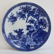 Chinese blue and white charger decorated with birds amongst trees and foliage, 37cm diameter