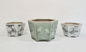 Pair of hexagonal 20th century Chinese jardinieres, the tapering bodies with each side decorated