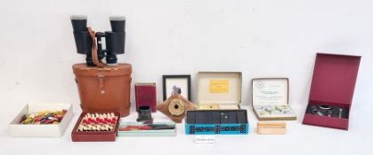 Pair of binoculars in leather case,a pocket chess and draughts, candle wax sealing set, dominoes,
