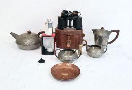 Four-piece Liberty Tudric pewter spot hammered teaset comprising teapot, hot water jug, milk jug and