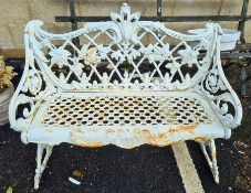 Intricately cast iron garden bench in the Coalbrookdale style, with pierced seat, the back decorated