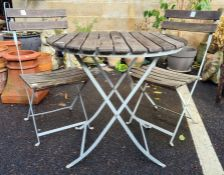 Iron-framed and wooden-slatted top circular garden table, diameter 75cm with two matching folding