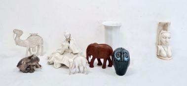 Royal Copenhagen modelof a puppy, no.1238/1407,a pottery modelof an owl,a carved elephant,a