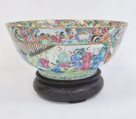 19th century Chinese Canton porcelain punchbowlpainted with figures in interior and gardens,