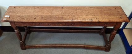 Oak bench, the rectangular top on four turned supports, block feet, stretchered base, 112cm x