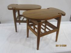 Pair of 20th century oval shaped coffee tables with undershelf, on tapering supports, 50cm approx