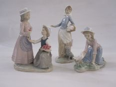 Nao figureof a girl with puppy and laundry, 25cm high, a Nao figure of two girls with posy of