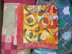 Various modern patchwork quilts, patchwork pieces and a large quantity of small remnants for