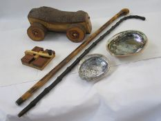 Two walking canes, a wooden turning toylabelled to reverse 'Chris Butcher Ghost Mill', two shells