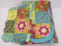 20th century quilt in turquoise, pink, yellow and green with turquoise backing with matching
