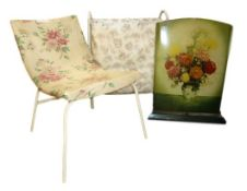 20th century vinyl chair with floral upholstery, a metal fire-screen with floral decoration of