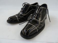 Prada brogues in black leather with white leather trim detail, size 37, in original box