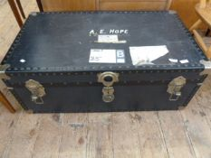 Large vintage travelling trunk with British Parcel Service label, containing a quantity of