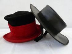 Philip Treacy black and red wool chimney pot-style felt hat and a Spanish leather riding hat